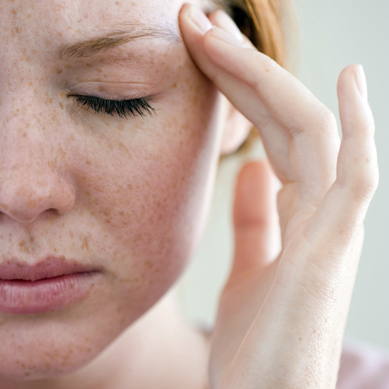 headache woman_ThinkstockPhotos