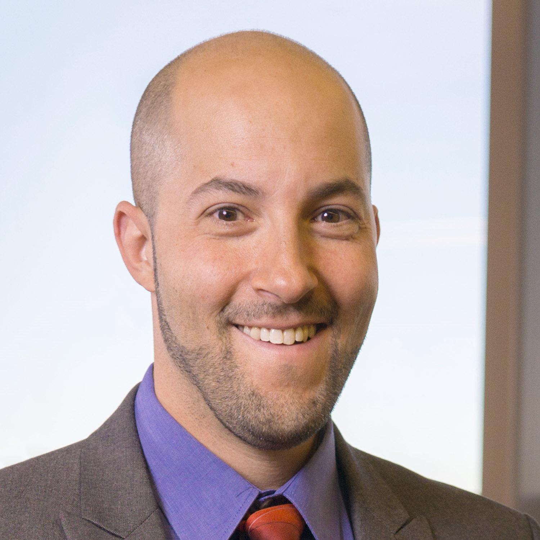 A photograph of Dr. Eric Garland.