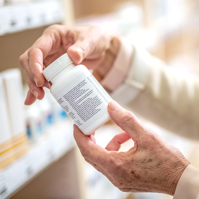 image of hands holding a medicine bottle