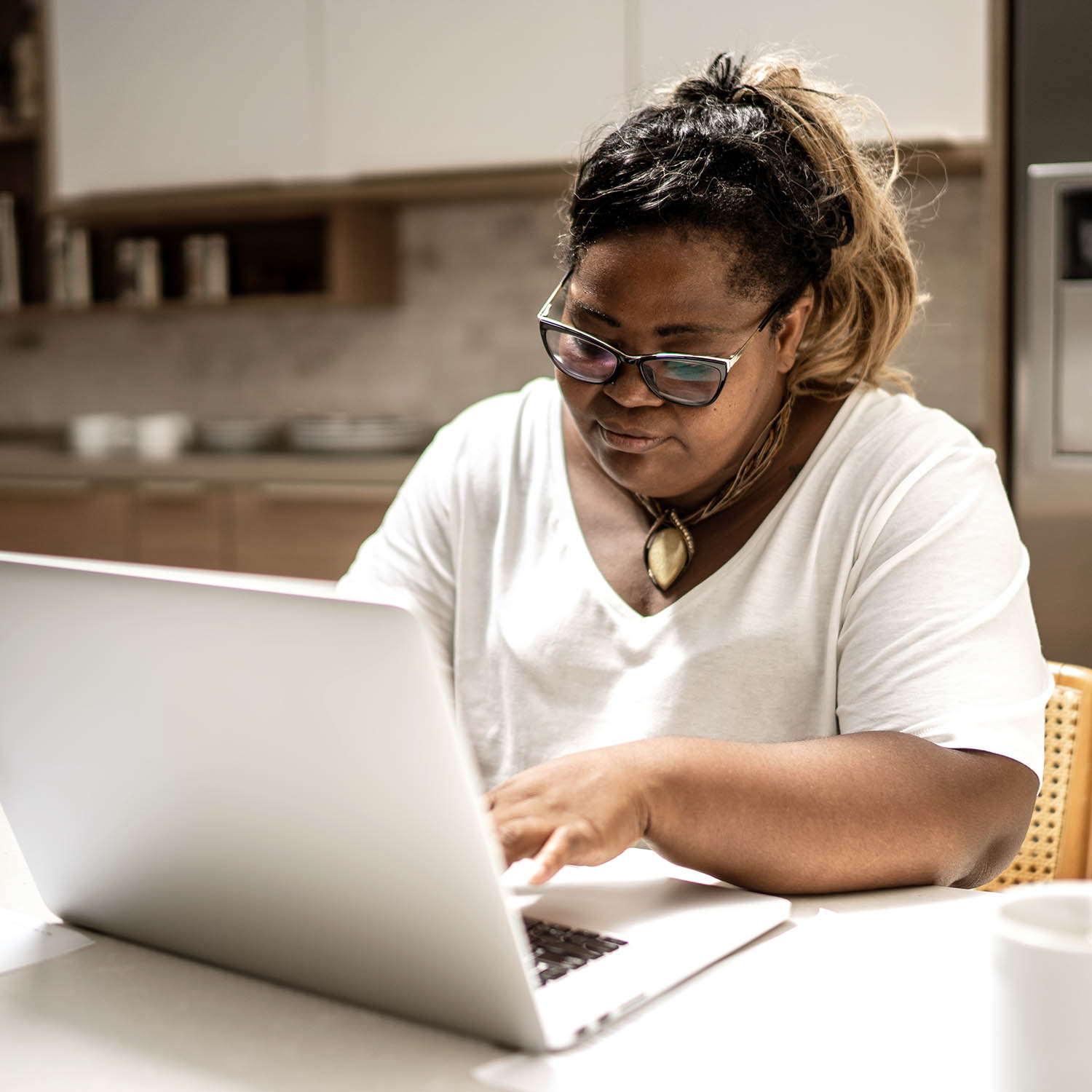 Mature woman using laptop working from home