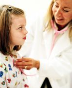 A child receives an exam from her health care provider. Copyright: JupiterImages