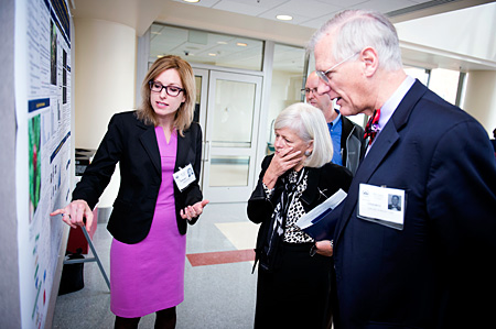 Dr. Nadja Cech describes her research to Drs. Briggs and Kingston.
