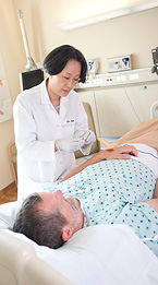 An acupuncturist works with a patient.