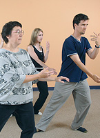 Students practice tai chi