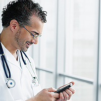 A doctor gets information on his mobile device
