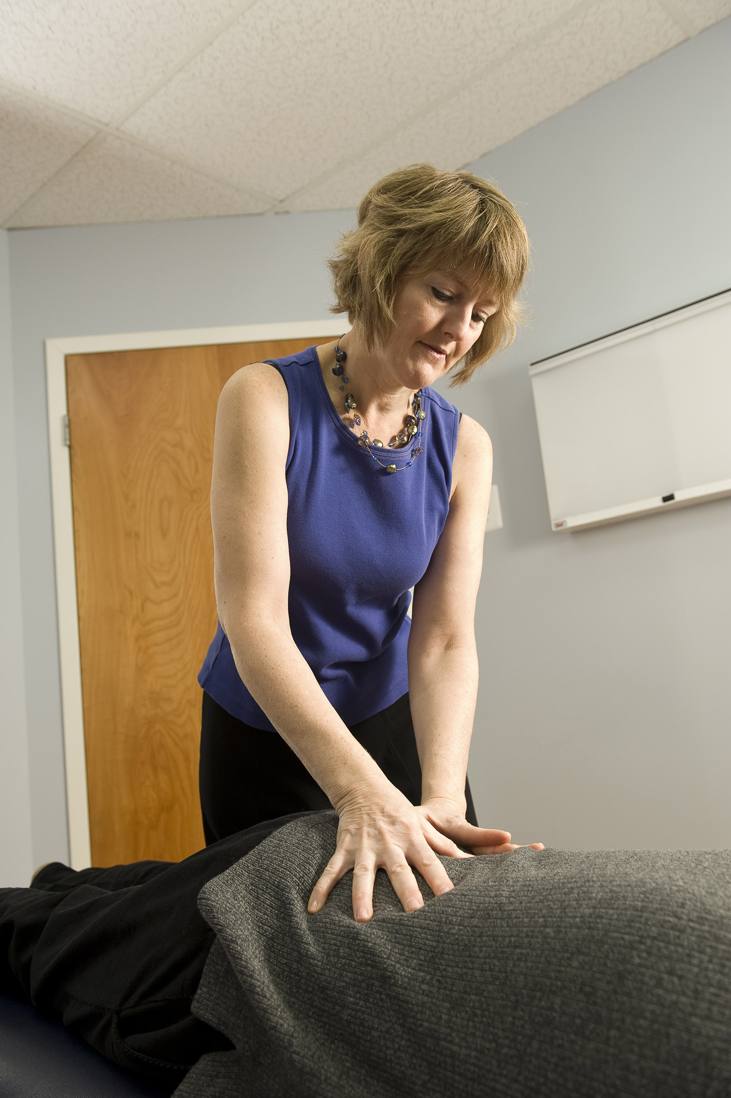 A chiropractor works on a patient.