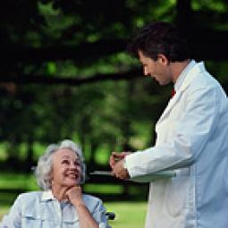 Doctor speaking to elderly woman.