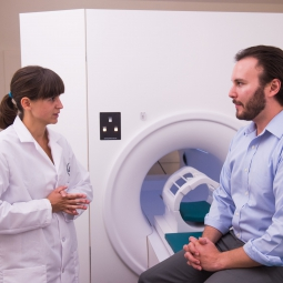 researcher discusses MRI study with participant