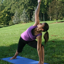 A woman practices yoga.