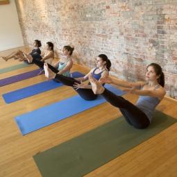 Photo of people practicing yoga.