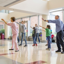 Adults and children learn Tai Chi