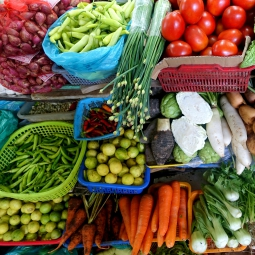 an assortment of vegetables in baskets