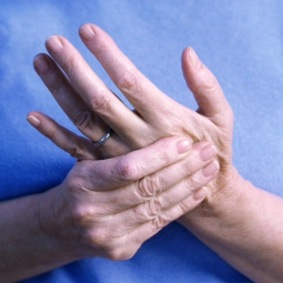 woman rubbing her hand