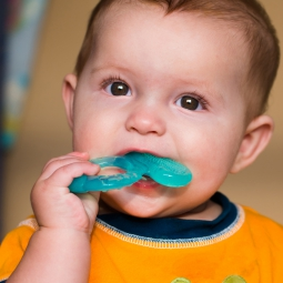baby with teething ring