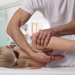 Chiropractor adjusting