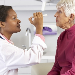 Eye doctor giving an exam to a senior citizen