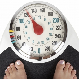 Person standing on a weight scale