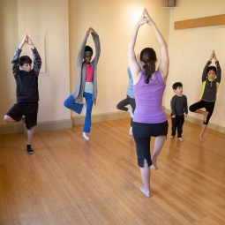Instructor teaching children yoga
