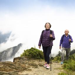 Senior Asian couple walking