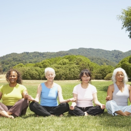 Photo of women meditating.