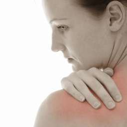 Woman suffering from fibromyalgia, chronic pain in her neck, shoulders, and back.