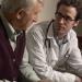 Doctor speaking to elderly man.