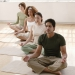 People in a meditative pose during a class on mats. © Jupiter Images
