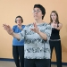 Women perform a tai chi exercise.