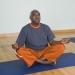 Senior doing a yoga pose on a yoga mat