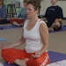 A woman practices a meditative yoga pose.
