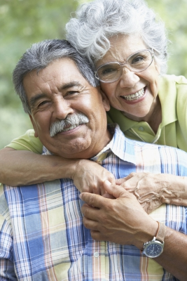 Older Hispanic couple holding each other