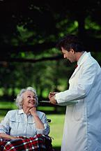 Doctor speaking to elderly woman.