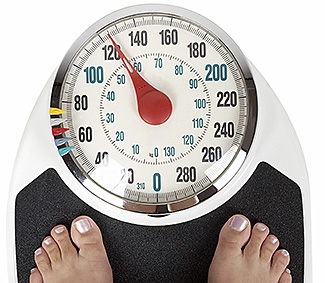 Person standing on a weight scale.