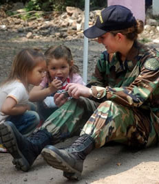 A photo of a military person with two children.