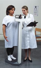 Young woman being weighed in at the scale