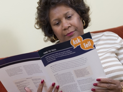 A woman reads material on patient-provider communication.