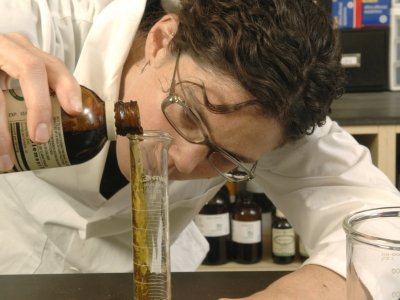 Herbalist compounding (preparing) an herbal extract.