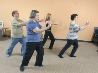 A community group practices Tai Chi