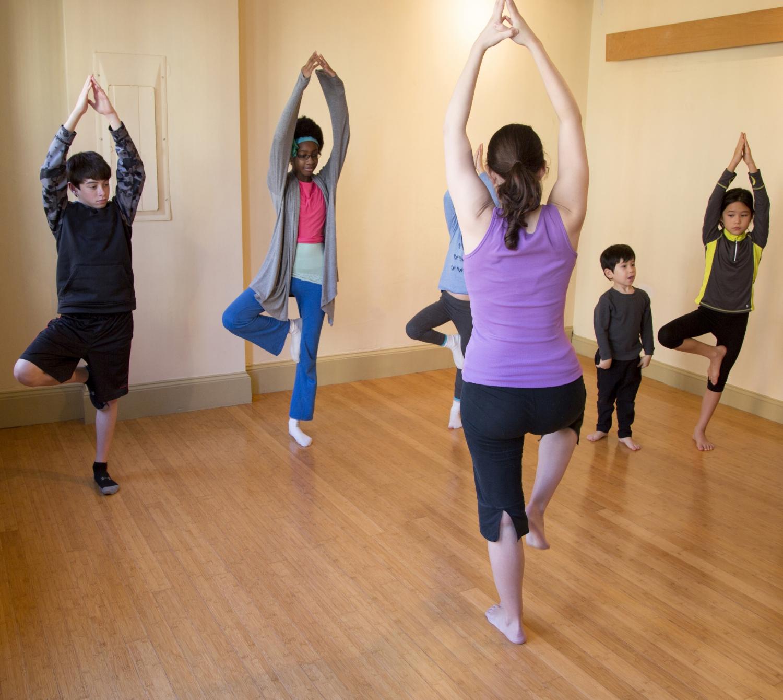 Instructor teaching children yoga