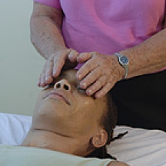 Woman performing Reiki.