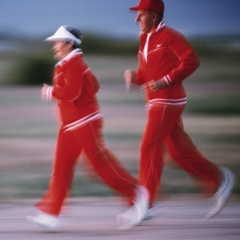A senior couple jogging. © Maartje van Caspel