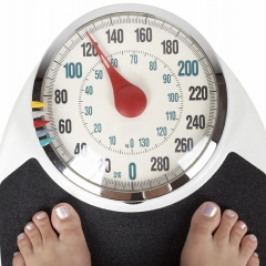 Person standing on a weight scale © istockphoto/tzara