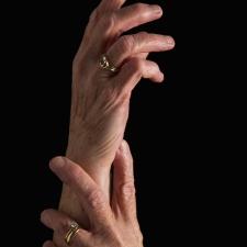 Woman holding wrist/hand. © VStock/Thinkstock