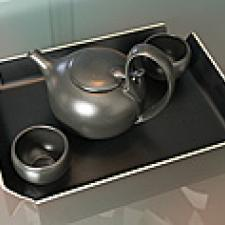Tea pot with two cups on a tray.