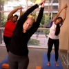 Three women practicing yoga