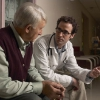 Doctor speaking to elderly man.