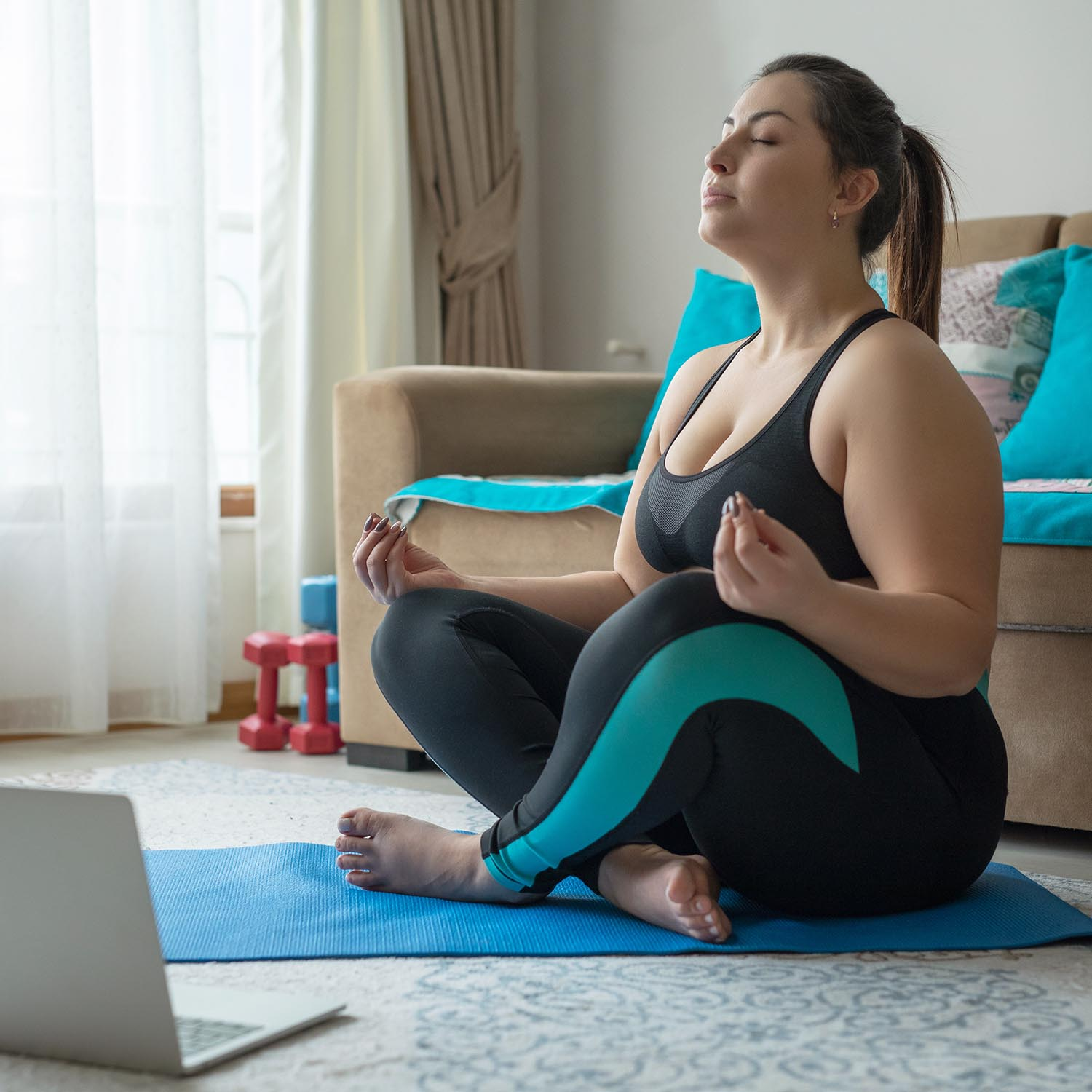 Overweight woman doing a yoga pose